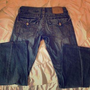 True Religion Sz 32 twisted hem jeans.